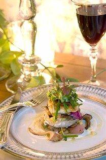 pan-seared fish, mushrooms and fresh microgreens.