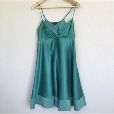 """The Limited Teal Silk Cocktail Dress Comfortable dress with a v-neck and adjustable straps. Flouncy skirt hits just below knee. The color of this dress is absolutely gorgeous and more blue-green than shown in photos. Fabric is 56% silk, 44% cotton. Wonderful condition. There are two creases on the middle lower back of the dress that a cool iron doesn't smooth out (see photo) but not very noticeable because of all the fabric on the skirt. Recommended dry clean. Flat measurements: bust 16""""…"""