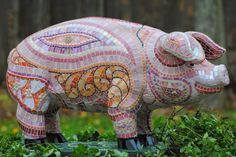 Some Pig!  Papier mache and then mosaic perhaps