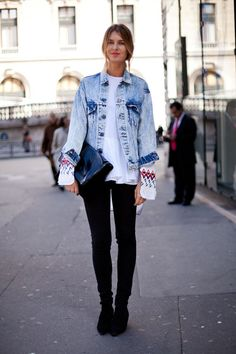 This girl makes an acid washed jean jacket work in a modern way.   - HarpersBAZAAR.com
