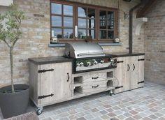 landelijke buitenkeuken van hout met bbq