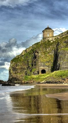 Mussenden Temple is a small circular building located on cliffs near Castlerock in County Londonderry, high above the Atlantic Ocean on the north-western coast of Northern Ireland.
