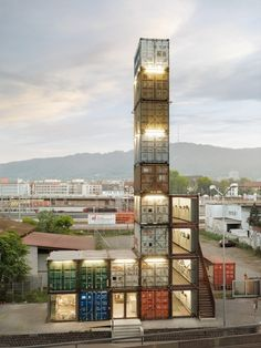 Zürich, Switzerland // World's Tallest Shipping Container commercial building 17 containers comprise the 4 stories of Freitag's new Zurich store, situated near the transit bridge with roof-top views of the city. Container Architecture, Architecture Module, Architecture Design, Amazing Architecture, Building Architecture, Sustainable Architecture, Shipping Container Buildings, Shipping Container Homes, Shipping Containers