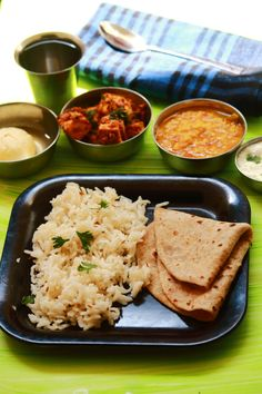 North Indian lunch menu - tasty and easy to make north indian lunch with jeera rice, roti, moong dal tadka, achari paneer, onion raita and rasgulla #indianfood #food #recipes #vegetarian #lunch