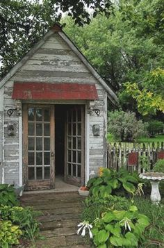 What a great gardening shed! Love the metal awning and doors