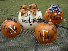 Family Name and each family member on faux pumpkins!