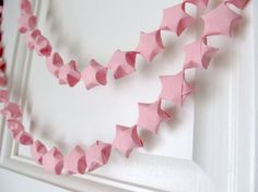 Origami Star Garland, Pink, Blue, Green, Purple, White or Yellow. $10,00, via Etsy.
