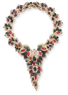 A RUBY, SAPPHIRE, EMERALD AND DIAMOND NECKLACE, BY MASSONI Designed as a carved ruby, sapphire and emerald foliate motif scrolling vine, enhanced by circular-cut diamond openwork foliate motif frames, the front suspending a similarly-set articulated cluster, with circular-cut diamond accents, mounted in 18K gold