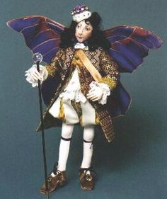"""Oberon""  Arrayed in the finest fabrics and trim, this exquisite 13"" free-standing King of the Fairies has magnificent painted silk wings.  Cloth Doll and Animal Making Sewing Patterns by  Suzette Rugolo"