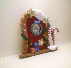 Polymer clay christmas themed fairy door.