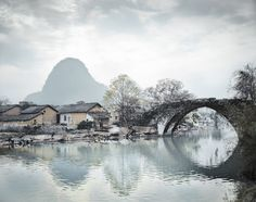 Snowy bridge with mountains - China Old & New | Stephen Wilkes