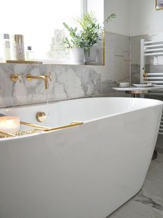 bathroom reno deep freestanding bath with 1 side attached to wall: Melissa Freestanding B Family Bathroom, Modern Bathroom, Small Bathroom, Master Bathroom, Small Freestanding Bath, Bathroom Ideas, Bathroom Tubs, Marble Bathrooms, Gold Bathroom