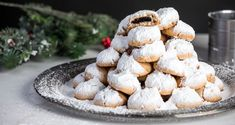 Chocolate filled almond cookies – Kourabiedes by Greek chef Akis Petretzikis. Scrumptious, crumbly almond cookies with chocolate filling, perfect for Christmas! Greek Sweets, Greek Desserts, Xmas Food, Christmas Sweets, Greek Easter, Filled Cookies, Chocolate Filling, Almond Cookies, Cookie Bars