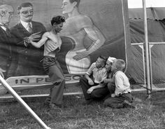 'The Man Without a Stomach' showing off to some kids at the 1944 Minnesota State Fair.  1944 Side Show | Flickr - Photo Sharing!