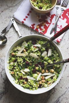 A simple and easy side dish for Shredded Brussels Sprout Salad. This fresh and flavorful salad recipe is a great addition to your Thanksgiving table or for an easy weeknight dinner recipe. Top with a protein for a full meal in one!