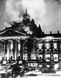 Berlin, Germany, 27 February 1933, an arson attack burns down Germany's Parliament, the Reichstag. The dedication 'To the German People' can be seen on the frieze. The Communists seem responsible and are accused, but they claim innocence and suggest that the act is self-inflicted. Whatever the case may be, President von Hindenburg used it to declare a state of emergency and to suspend civil liberties.