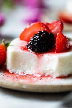 This simple Yogurt Panna Cotta is the perfect smooth, creamy dessert. The cool tang of yogurt pairs perfectly with fresh berries. To macerate the berries simple mix them with a little sugar and let them sit. #skinnytaste #yogurt #pannacotta