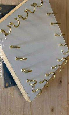 Hang kitchen utensils from hooks on a board that's suspended from a turntable. Use a round cutting board?