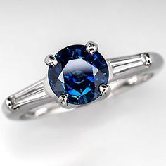 round sapphire with baguette accents set in platinum