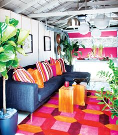 Pink and orange liven up this converted garage into a fabulous outdoor space!