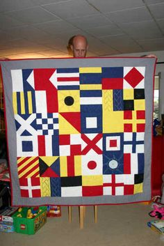 Nautical flags quilt Quilt Baby, Nautical Baby Quilt, Nautical Flags, Nautical Design, Quilting Tutorials, Quilting Designs, Map Quilt, Beach Quilt, Summer Quilts