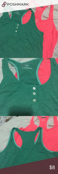 Two tank tops One is a cute green and the other a pink both shirts included in purchase Tops Tank Tops