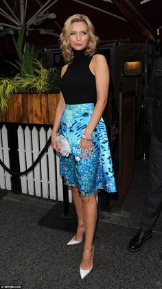 Glamorous as ever: The 29-year-old Countdown presenter stood out from the crowd in a bold ...