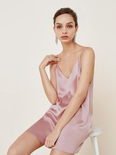 mini length satin slip dress with adjustable straps and a v neckline.