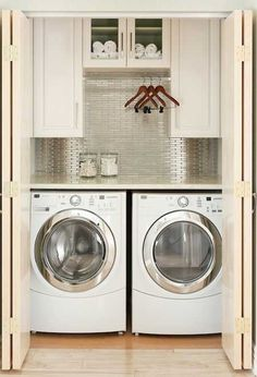 Home-Dzine - Organize your laundry room. Steel tiles mosaic backsplash, white cabinets,