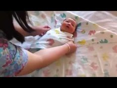 Learn the double baby swaddle with hood - YouTube