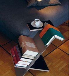 Very thoughtful bookshelf... need to make several of these to deal with current…
