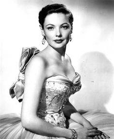 "Gene Tierney in a gown designed by William Travilla for ""On the Riviera"" in 1951"