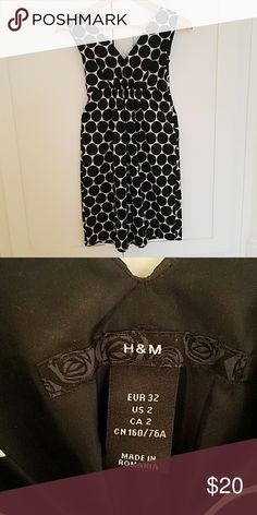 H&M Knee Length Dress Black polka dot sleeveless dress from H&M. Satin material with a side zip for good fit. 'V' neck in the front and back. Worn once and is in excellent condition. H&M Dresses Midi