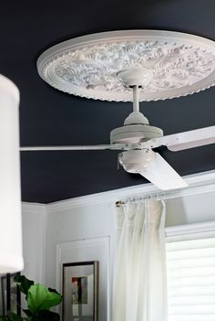 can't ditch the ceiling fan but don't want it to stick out like a sore thumb - LOVE this medallion solution from Hunted Interior!