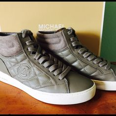 Michael Kors Paige Suede High-Top Sneakers Gray MICHAEL MICHAEL KORS PAIGE LEATHER HIGH-TOP SNEAKER $185.00 COLOR: STEEL GREY STEEL GREY Paige Leather High-Top Sneaker  by Michael Kors BLACK Paige Leather High-Top Sneaker  by Michael Kors  STYLE NOTES DETAILS Kick your sneaker game up a notch. Intricate quilted stitching lends tactile appeal to our high-top Paige sneakers for an elevated take on a sporty staple. As comfortable as they are cool, this luxe leather and suede pair is the…
