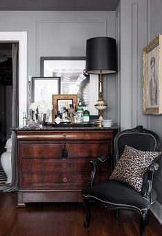 love how this chic bar blends seamlessly into the layered art and gorgeous decor