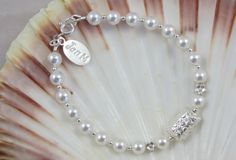 Delightful bracelet in freshwater Pearls with little silver balls, daisy embossed pillow with matching flat daisy beads, all silver used throughout is 925 sterling silver.