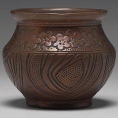 """Unusual Clewell vase, copper-clad pottery, using a Weller Burntwood blank with a floral design, good original patina, unmarked, 4.5""""w x 3.5""""h"""