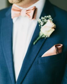 When you're this dapper of a groom all you need is a sweet white rose kissed by a champagne hue and a petite bunch of baby's breath.   Photo by Cinderella Wedding Co.