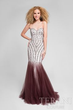 Strapless form fitting special occasion designer dress with intricately placed bead design that flows into tulle insets which form a full skirt. This is the perfect dress for prom night and comes in taupe/ivory, silver/nude, aqua/nude and nude/nude. Our formal event dresses are red carpet ready.