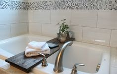 Or lay a table across your bathtub so you have a spot for your book, as well. 21 Hella Cheap Ways To Make Your Bathroom Look More Expensive Bathtub Table, Bathtub Decor, Power Trip, Cheap Baths, Bathroom Hacks, Bathroom Ideas, Bathroom Remodeling, Home Ownership, Home Look