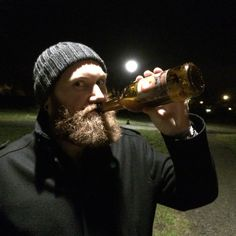 This sailor is in it for the long haul! Drinking my beer with a vengance! Knitted hat, black coat and big beard.