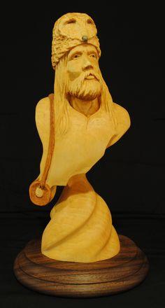 Mountain Man - Basswood mounted on walnut, 12x5x5. Mark Gargac rough out.