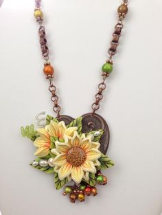 A sweet treat combining findings from B'sue Boutiques and amazing polymer clay flowers from Irene Hoffman.   And....spectra beads!