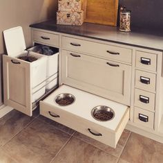 The Kessebohmer waste bin pullout unit was featured in Apartment Therapy's article 10 Clever Hidden Storage Solutions You'll Wish You Had at Home. Thanks Wood Mode for the great photo. Animal Room, Dog Food Storage, Hidden Storage, Storage Ideas, Dish Storage, Cabinet Storage, Wood Storage, Storage Bins, Drawer Ideas