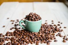 coffee coffee beans coffee cup full of coffee beans toned image
