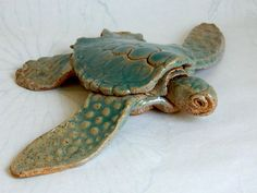 This one-of-a-kind turtle was hand-built by me and fired in an electric kiln. The jade green glaze is translucent and shows off all of the detail on her