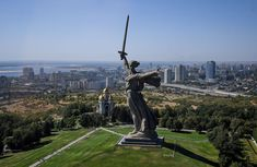 An aerial photo shows the Mamayev Kurgan World War II memorial complex with the statue The Motherland Calls in Volgograd, Russia, on August The monument, the tallest statue in Russia, stands 279 feet meters) tall. Battle Of Stalingrad, Round Building, Concrete Sculpture, Sculpture Art, Catacombs, Image House, What Is Like, Statue Of Liberty, Beautiful Places