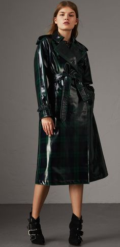 A high-gloss Black Watch tartan wool trench coat. The relaxed cut has a pronounced storm shield and deep back vent for volume. Mix and clash your patterns to make the plaid pop. Red Raincoat, Wool Trench Coat, Plaid Coat, Rain Jacket Women, Burberry Trench, Raincoats For Women, Lookbook, Rain Wear, Lana