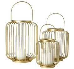 Add a touch of gold glamour to any outdoor wedding reception with these hanging hurricane candle holders